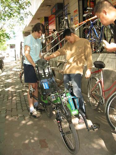 Marija showing her bike off at a bike shop in Urumqi, Xinjiang Province, China