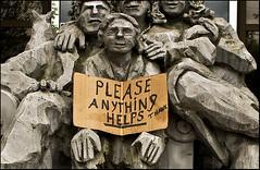 Anything helps... (Crickontour) Tags: seattle plaza people dog brick sign statue grey frozen washington odd help cardboard guesswhereseattle seattleunguessed