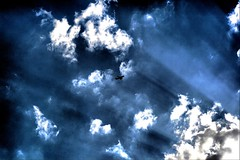 the plane in the blue sky (Caucas') Tags: blue light sky cloud mer azul clouds digital plane canon turkey eos rebel lights la landscapes ray air trkiye trkei blacksea karadeniz mavi turquia turkish hava noire sinop uak sinope xti
