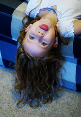 I hope you have one of these hanging around your house, too. (simply colleen) Tags: girl tongue carpet nikon child upsidedown blueeyes couch hanging silliness stickingouttongue d60