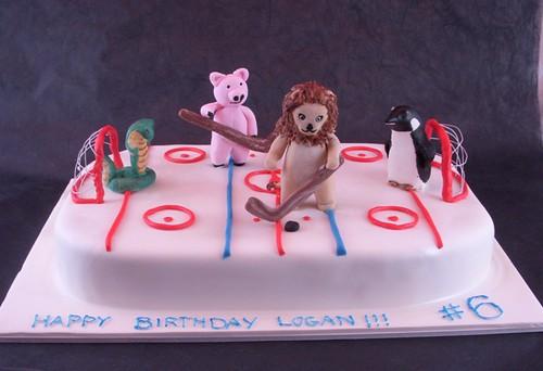 Animals playing hockey cake