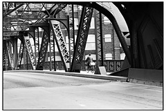 Another Number for the Road (swanksalot) Tags: bridge bw bike strangers swanksalot sethanderson