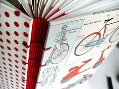 DSCN2331- (thekateblack) Tags: blue red bike bicycle vintage notebook book stitch handmade album diary journal bikes scooter sketchbook bicycles polkadots motorcycle stitching etsy bookbinding coptic photoalbum reused blankbook cherryred reworked handbound exposedspine polkadotted kettlestitch kateblack kateblackcom vintagebookpage modernbicycle modernbicycles