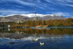Mellat Park Lake in Fall, Tehran, Iran (Persia) (eshare) Tags: park bridge autumn trees sky cloud mountain lake mountains reflection tree fall clouds landscape persian duck iran lakes bridges gimp ducks persia iranian tehran  hdr highdynamicrange iranians teheran  persians snowymountains        mellatpark      urbanparks  tthdr kakadoo hdrfromasingleraw sonyalphadslra100     sal20f28 dynamicphotohdrsoftware  dphdr    100 sonyalpha20mmf28lens 2028