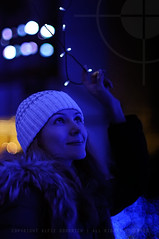 Katia under the Christmas lights; Shidome, Tokyo (Alfie | Japanorama) Tags: christmas blue winter woman cute beautiful hat japan lady lights tokyo nikon focus pretty manual belarus russian shiodome wintry d300 belarussian professionalmodel nikkor50mmf12ai