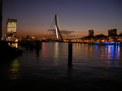 Erasmusbridge & Euromast In Twilight - Rotterdam - Holland (Leo Roubos) Tags: bridge sunset sky holland reflection building water netherlands night reflections river lights twilight rotterdam shot nightshot erasmus nederland hendrikkade van kpn maas kop euromast erasmusbrug meuse zuid prins noordereiland wilhelminakade rivier erasmusbridge feijenoord binnenhaven binnenhavenbrug koningshaven stieltjesstraat nightsbestimages