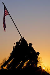 Forever brave (Rozanne Hakala) Tags: sculpture usa history tourism silhouette statue usmc bronze arlington sunrise outdoors dawn dc washington marine memorial flag military wwii americanflag tourist corps va soldiers rosslyn flagpole iwojimamemorial iwojima 1on1sunrisesunsets disctrictofcolumbia raisingtheflagoniwojima usmarinecorpswarmemorial