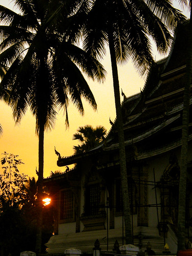 Sunset behind temple in Luang Prabang