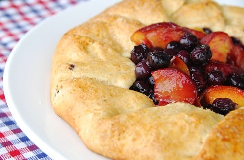 blueberry peach galette on checkered mat