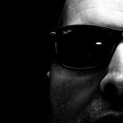 portrait blackandwhite bw me face sunglasses self canon square eos gesicht sigma 11 porträt explore half sw whatever 2008 ich halb sonnenbrille rayban 1x1 selbst quadratisch manray 500x500 wasauchimmer schwarzundweiss banray canoneos400d sigma1770mmf2845dcmacro canondigitalrebelxti schwarzundweis onkelwart 500x500contest45 500x500selfportraits