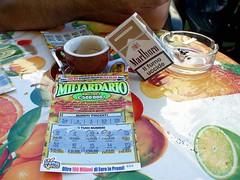 ... mah?!? (ilPARTOdelleNUVOLE) Tags: foto katia tazzina calabria grosso colazione sigarette diamante cosenza grattaevinci estate2008 agosto2008 piazzaxifebbraio