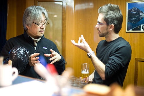 Ryuichi Sakamoto with Sam Collins discussing how climate change affects the Arctic