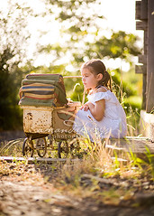 White dress and an antique pram ({amanda}) Tags: overgrown girl spring afternoon child antique rusty mykid 85mm naturallight rusted pram whitedress 6years sixyears amandakeeysphotography