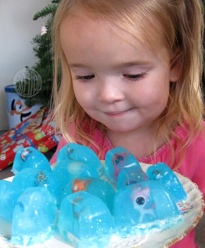 Little child holding tray of snow globe soap bars