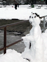 Snowboy at the seaside (Ruth and Dave) Tags: snow beach vancouver snowman holding kits kitsilano railing leaning snowboy