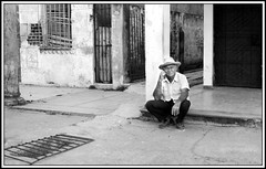 Where Time Has Died (redmann) Tags: portrait blackandwhite bw man canon candid cuba sigma streetscene caribbean ciegodeavila canon400d anawesomeshot aplusphoto sigma18200dcos ciegodeavilaprovince