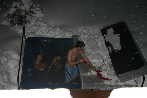 Shoveling snow off the hot tub
