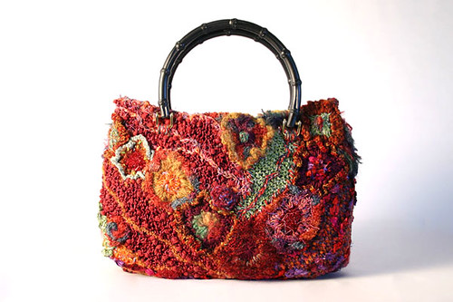 Red freeform handbag by Prudence