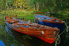 Derwent Water Row Boats - Lake District (Ian Lambert) Tags: autumn lake reflection water boats district derwent lakes row calm cumbria keswick