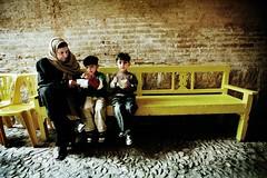 Ice cream (Ola Jacobsen) Tags: film yellow stone bench landscape twins iran icecream shiraz passage bazar fars canoneos1n canonef1735mmf28lusm