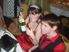 Sarah and Joe with the bottle of champagne (Elysia in Wonderland) Tags: red tiara sarah bottle dress singing champagne joe prom elysia