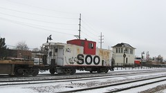 Lightly grafitti tagged former Soo Line wide vision caboose. Franklin Park Illinois. December 2008.