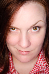 smirk (poopoorama) Tags: portrait woman nikon sigma margaret ringflash orbis d300 strobist 1850mmf28exmacrohsm
