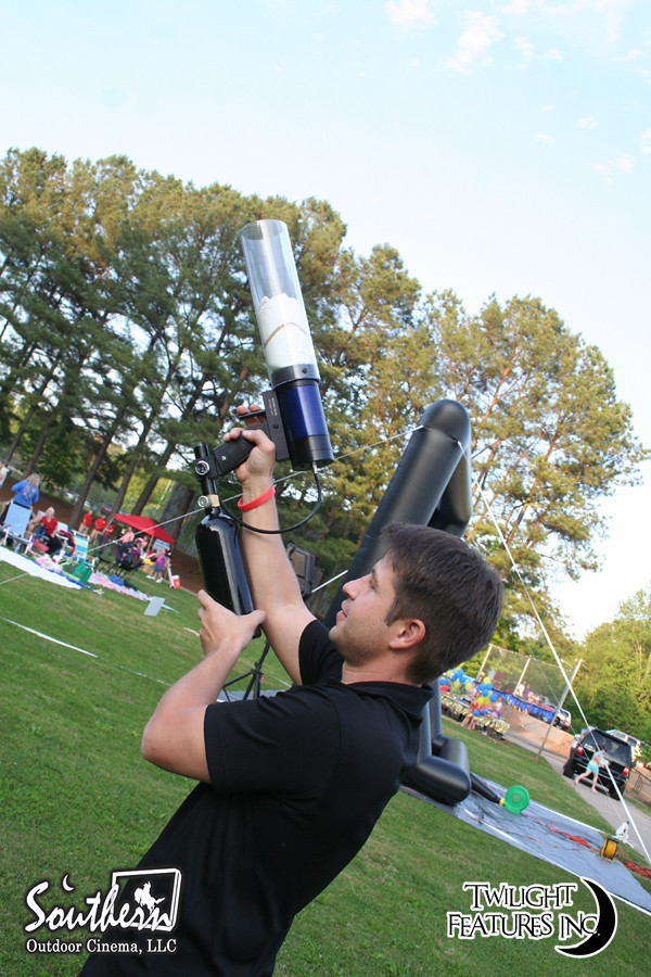 T-shirt cannon at outdoor movie event