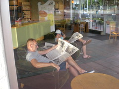 Two Men Reading Newspapers
