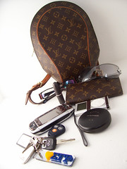 What's in my Bag? (cutieerica) Tags: whatsinyourbag viper ipodmini authentic lv louisvuitton rocawear infinitig35 maclipstick sidekick3 sigmagammarhosorority guccieyeglasses louisvuittonellipsebackpack macstudiofix