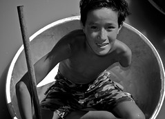 ....Sadness Not Required.... (Quinn Ryan Mattingly) Tags: life boy people lake water living boat bucket missing cambodia sad with arm near bowl siem reap but less sap tonlesap fortunate tonle earthasia cambodiajuly2008