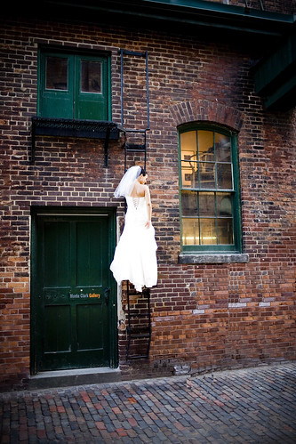 Bride on fire escape ladder