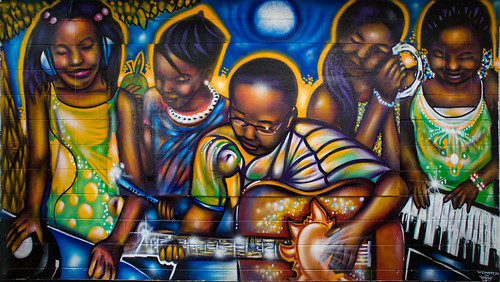 mural of African-American boys and girls playing instruments with joy!