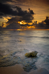 Beached Rock! (mcazadi) Tags: clouds sunrise mexico rocks beached cancun filters wonderworld goldblue singhray isawyoufirst ysplix theunforgettablepictures theunforgettablepicture theperfectphotographer 3stopndgrads