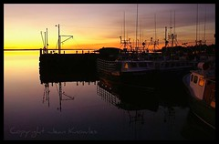 Fishing boats at dawn (Jean Knowles) Tags: morning pink blue light orange rose yellow sunrise reflections boats gold dawn novascotia horizon peach indigo silhouettes explore arr geotag allrightsreserved shagharbour shelburnecounty colorphotoaward takeitoutside crystalaward nottobeusedwithoutmypermission betterthangood copyrightjeanknowles boatislandpoetry