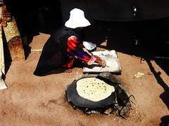 Bedouin Woman making bread (Ibrahim A. Khalil) Tags: woman cooking bread desert egypt tent valley making sinai bedouin