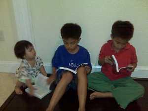 Kids read Secrets to Paradise