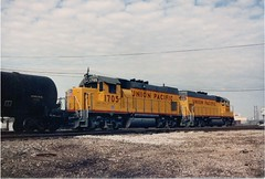 Union Pacific EMD model GP-15 light roadswitchers and tank cars at Hayford Junction. Chicago Illinois. May 1987.