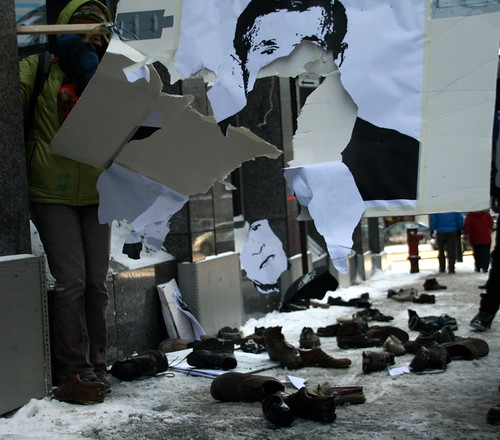 Protesters Throwing Shoes at Bush posters in Montreal by Anirudh Koul.