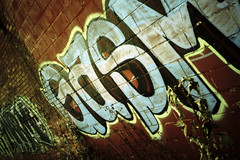 OR (Ralph Krawczyk Jr) Tags: urban art 35mm typography graffiti xpro angle orgasm crossprocess bricks perspective filmcamera olympusxa2 pleasure compact climax expiredfilm detroitmichigan boomgoesthedynamite fujisensia200 allrightsreserved rckrawczykjr ralphkrawczykjr