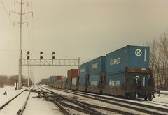 Northbound double stack container train. La Grange Park Illinois. January 1987.