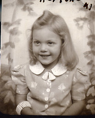 Harlene in a photobooth in 1941 (lovedaylemon) Tags: girl smile vintage found photobooth image backdrop leafy 941