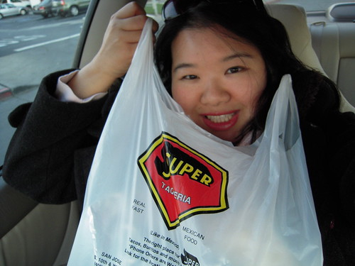 Joz holds the take-out Super Taqueria food.