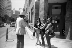Street preaching (QsySue) Tags: street city girls people panorama losangeles downtown toycamera panoramic sidewalk 35mmfilm pedestrians littletokyo 35mmcamera keystoneeasyshot455panorama bignameforalittlecamera ididntevenhavetoflipthelensonthisone itookthemaskout