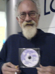 John Sinclair, with his copy of Agit Disco 1