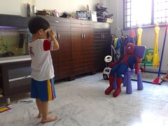 Isaac takes a photo of Spider Man