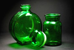 Green Bottles (floralgal) Tags: stilllife green glass reflections bottles artistic creative brightcolors greenglass glassart greenbottles fineartphotos greenonblack mywinners abigfave tabletopstilllife decorativeglass decorativebottles brightcoloredglass