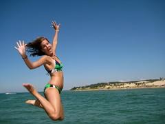 Waaah! (rkramer62) Tags: beach girl geotagged jump michigan lakemichigan silverlakesanddunes geo:lat=43897892 rkramer62 geo:lon=85693359