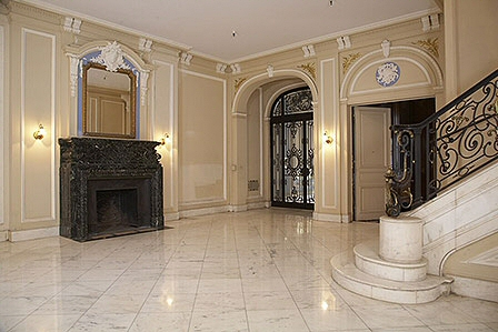 The entryway is impressive. I can see coming home from Abercrombie & Fitch  to a roaring fire in that hearth.