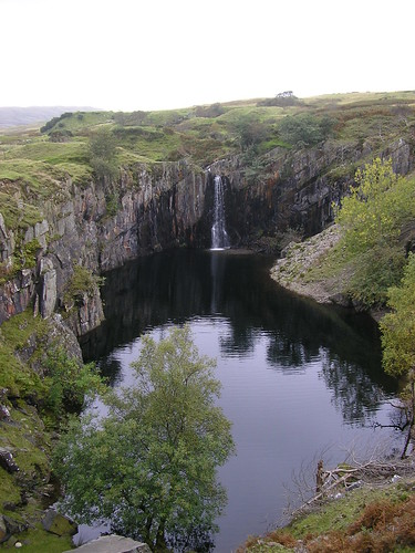 Waterfall into the remains of a quarry